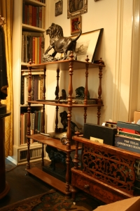 The etagere in the library which holds six bronze sculptures, was surprisingly completely stable.  Steve's only suggestion was to make sure that the three legs that rested on hardwood be brought to the same level as the one on the carpet.  Easy!