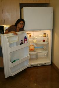 Sylvia shows the lack of food in the staff fridge - time to take one of Rob's suggestions!